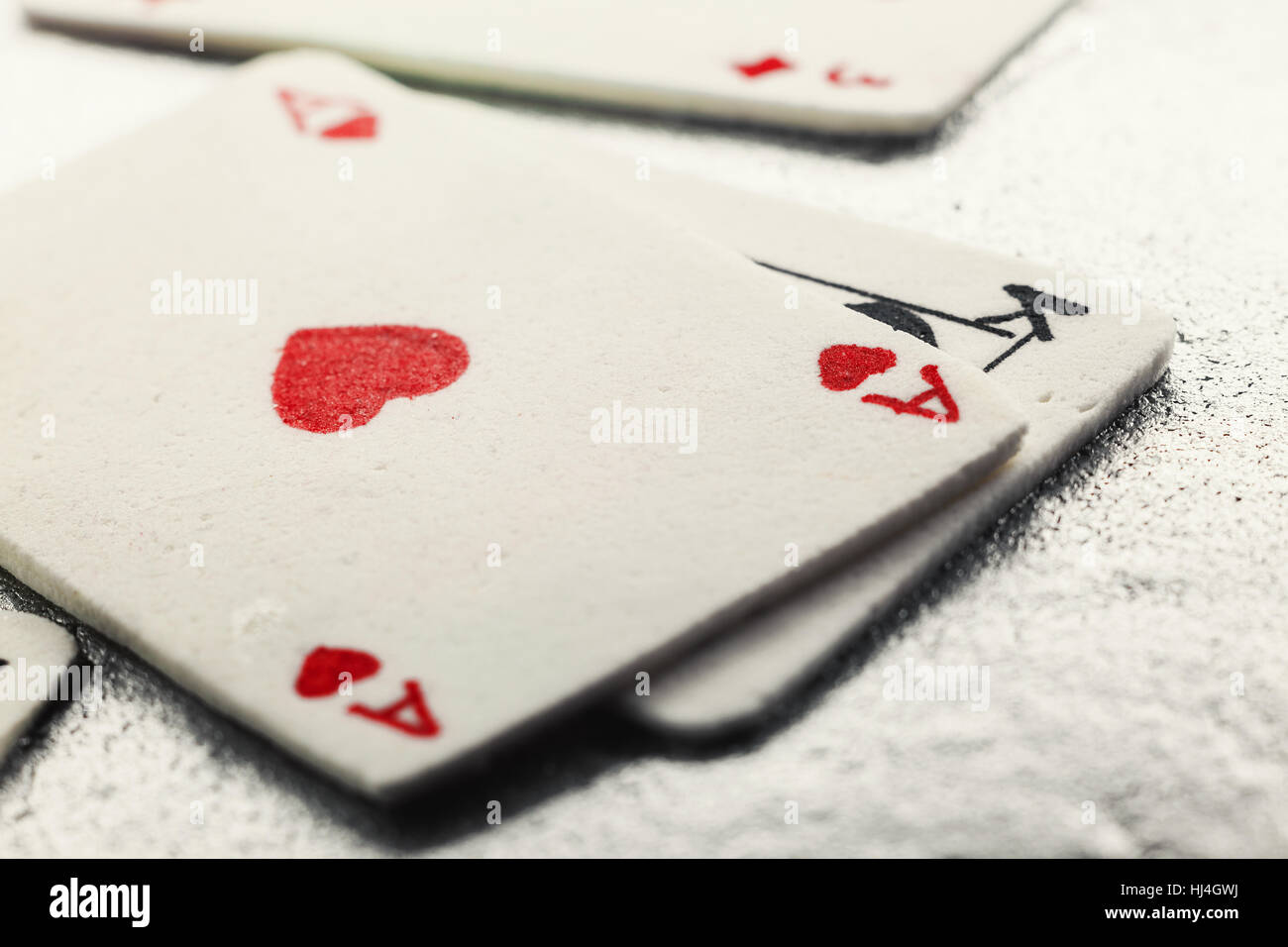 Decoration of a cake, gambling cards made of fondant. - Stock Image