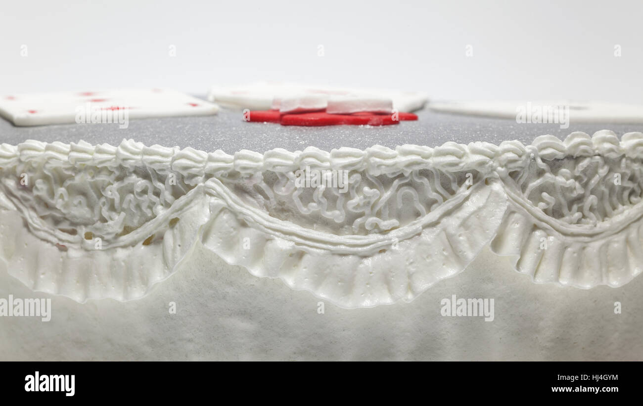 Decoration of a birthday cake, details of white cream. - Stock Image