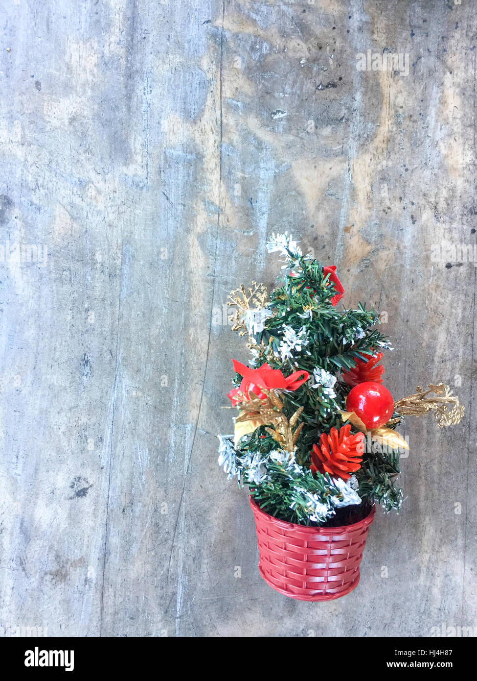 Small Christmas Tree Decoration Hanging On The Wooden Wall Stock Photo Alamy