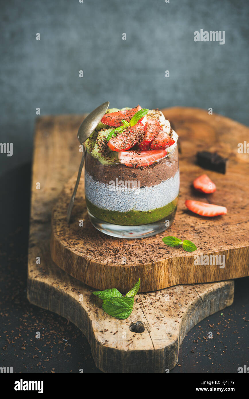 Matcha, almond milk, cocoa chia seed pudding, fruits, mint, chocolate - Stock Image