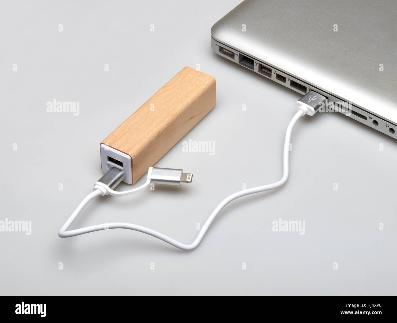 Wooden portable external power bank, for emergency phone recharge isolated on white with clipping path - Stock Image