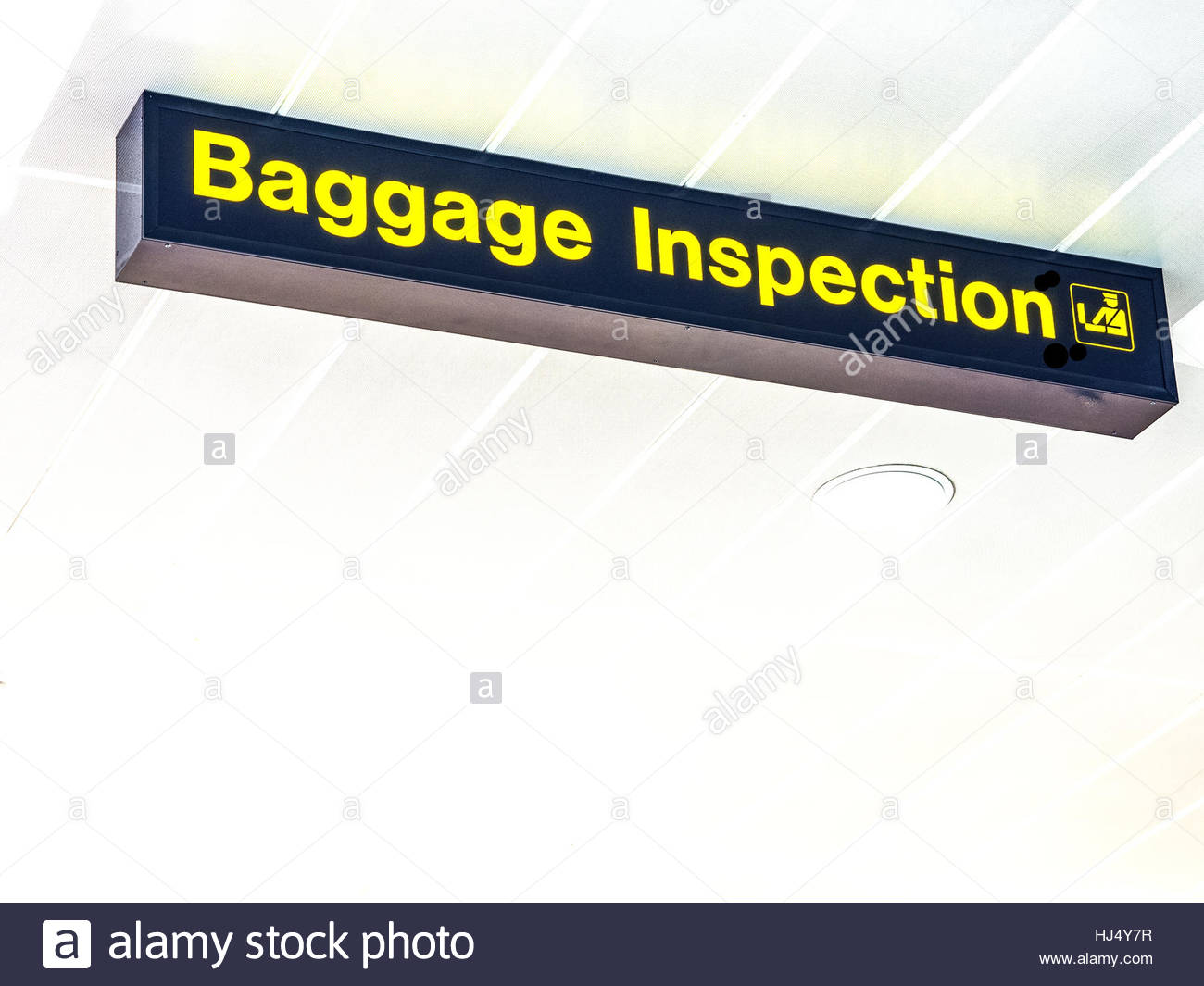 Baggage Inspection airport sign with near white background. - Stock Image