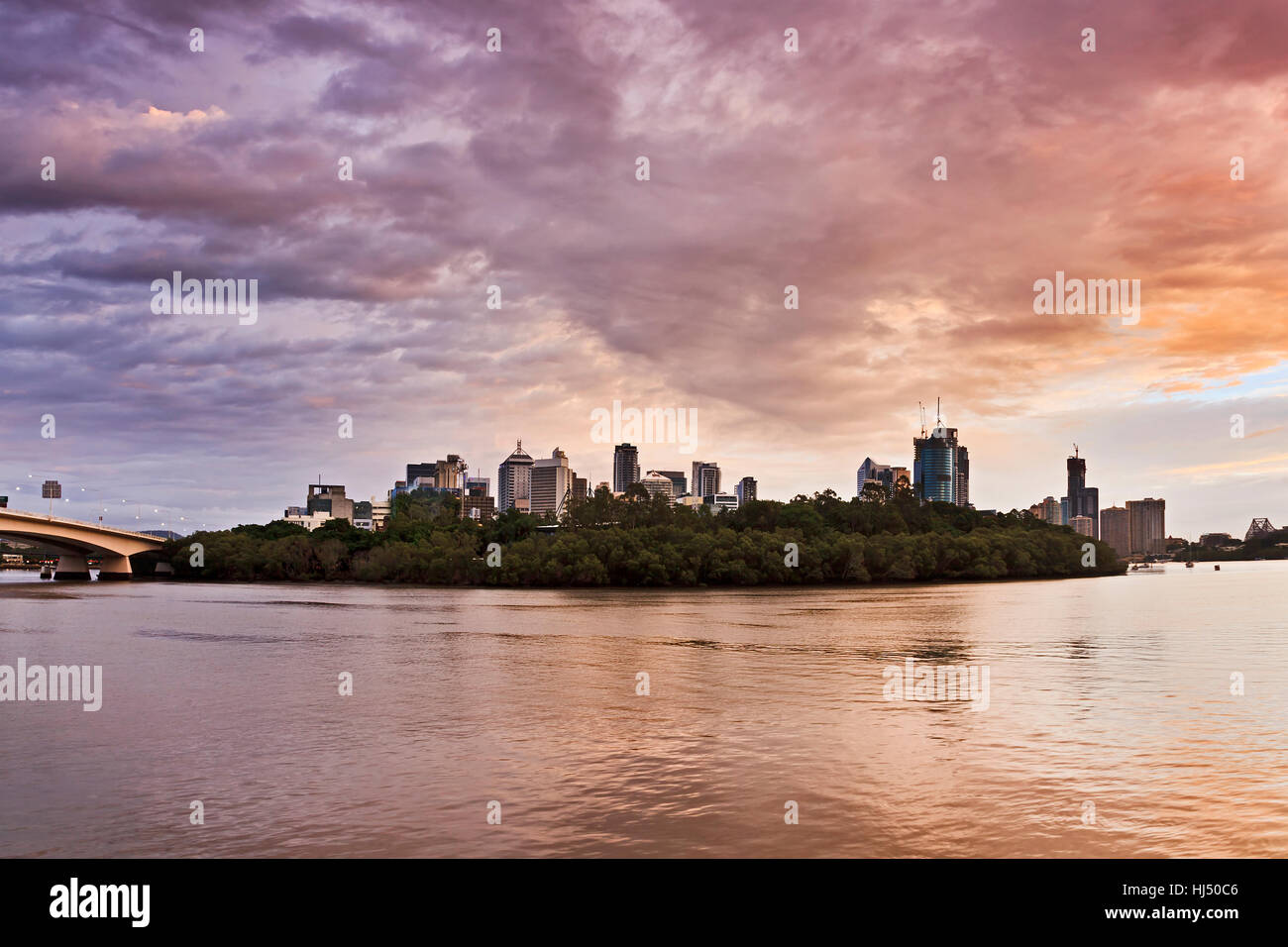 Brisbane city CBD view across Brisbane river over parkland and waterfront between famous Queensland's capital - Stock Image