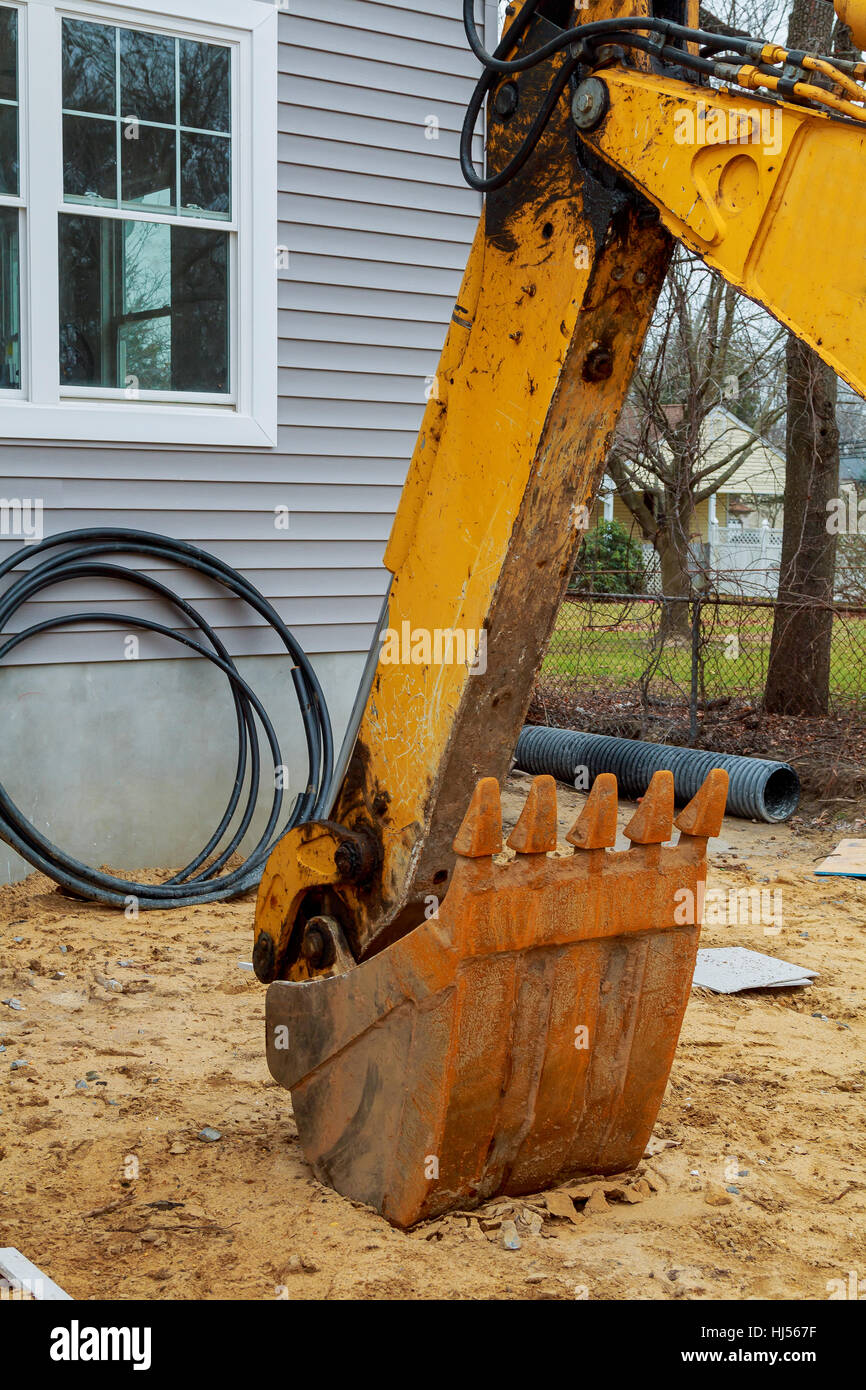 The orange bucket of the excavator. bucket excavators - Stock Image