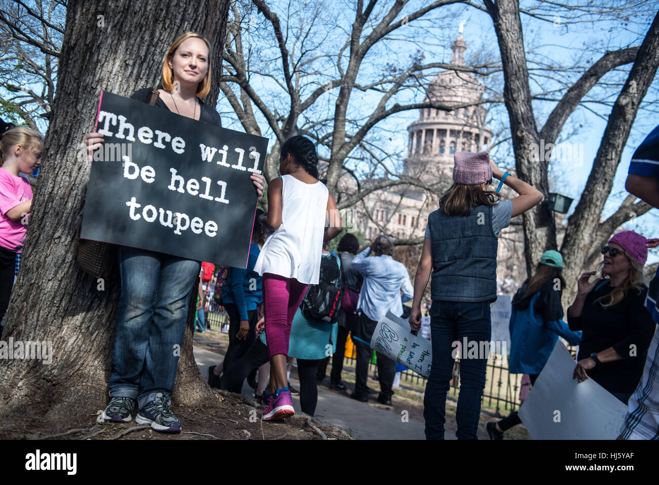 Austin, Texas, USA. 21st January, 2017. A young woman holds a humerous anti-Trump banner near the state capitol - Stock Image