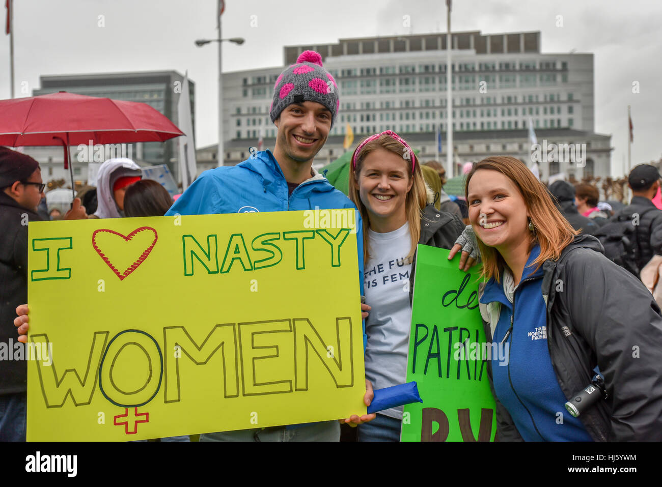 San Francisco, California, USA. 21st January, 2017. Young man holds nasty women sign next to female friends during Stock Photo