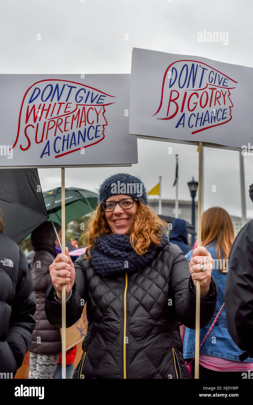 San Francisco, California, USA. 21st January, 2017. Woman holds signs about not giving bigotry or white supremacy - Stock Image