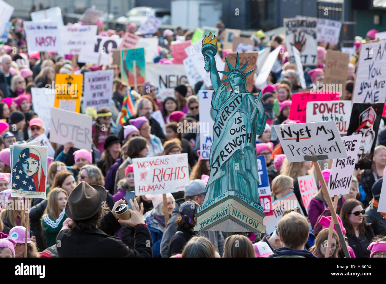 Seattle, United States. 21st Jan, 2017. Seattle, Washington: Supporters pass through Pioneer Square. Over 100,000 - Stock Image