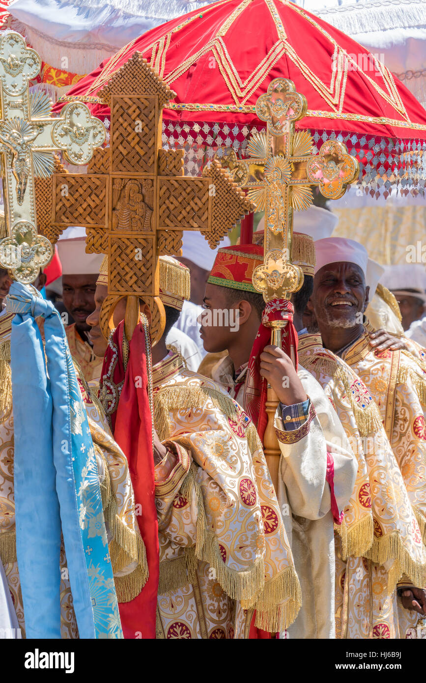 Addis Ababa - Jan 19: Priests wear colorful traditional gowns worn by the Ethiopian Orthodox Clergy, during a Timket procession as part of celebration Stock Photo