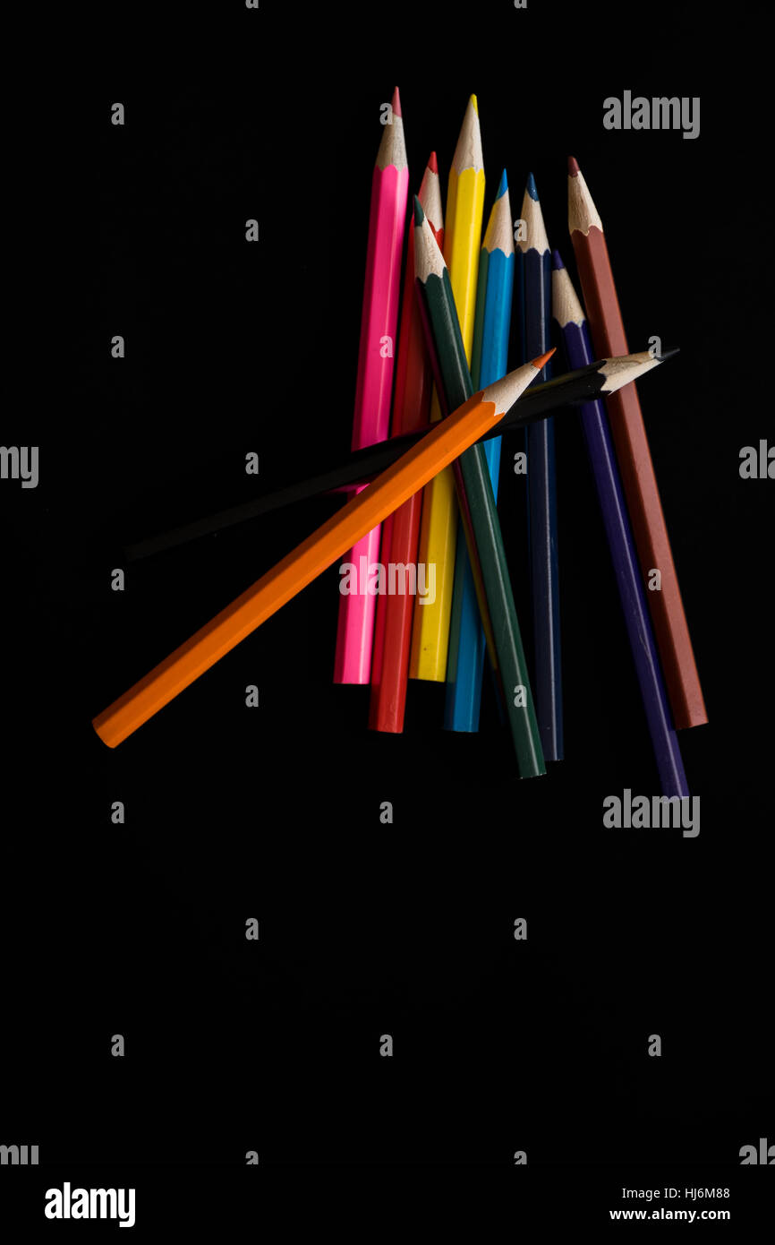 colored pencil in group with black background - Stock Image
