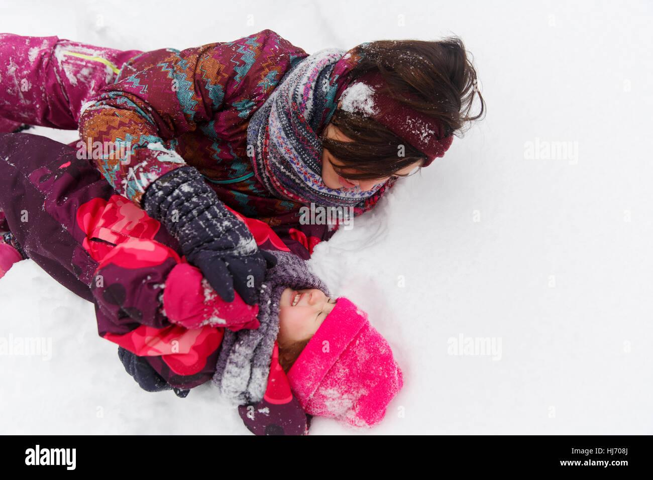 Brunette ,daughter in snowy park - Stock Image