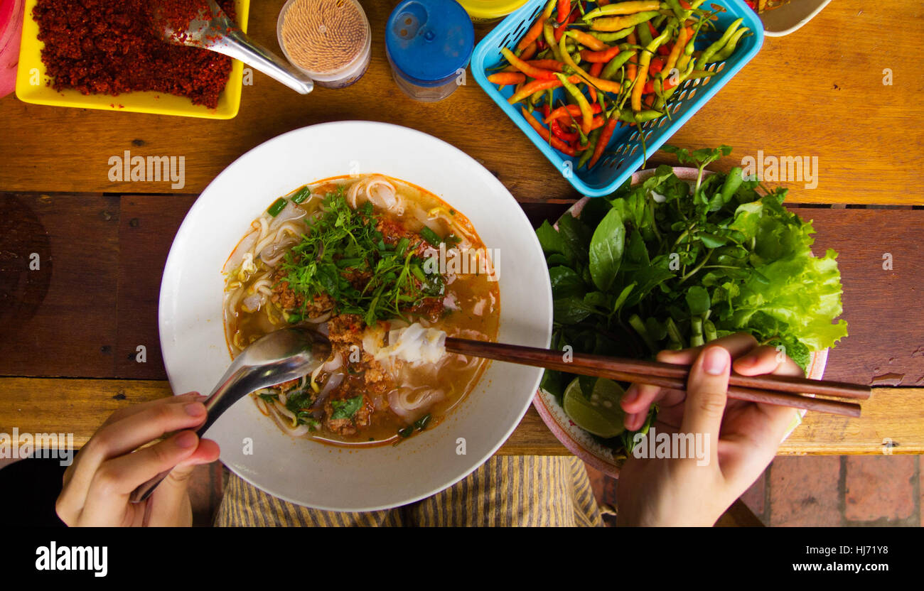 Rice noodles with pork and chili paste in Luang Prabang, Laos - Stock Image