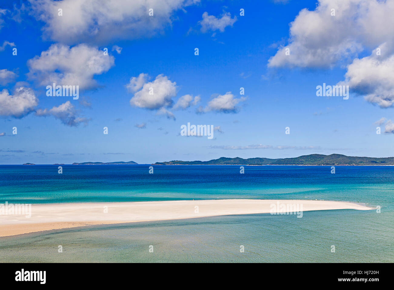 Coral sea great barrier reef whitsundays islands whitehaven beach of white silica sand and clean water on a sunny - Stock Image
