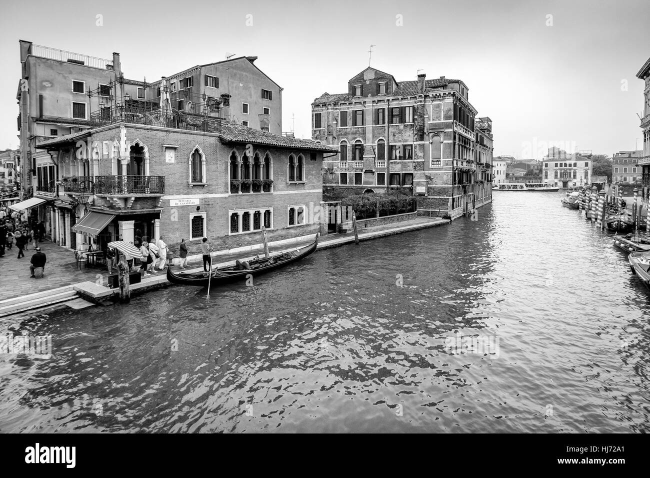 Venice, Italy - October 16, 2016: view of a Venice canal in Italy with gondola and tourists - Stock Image