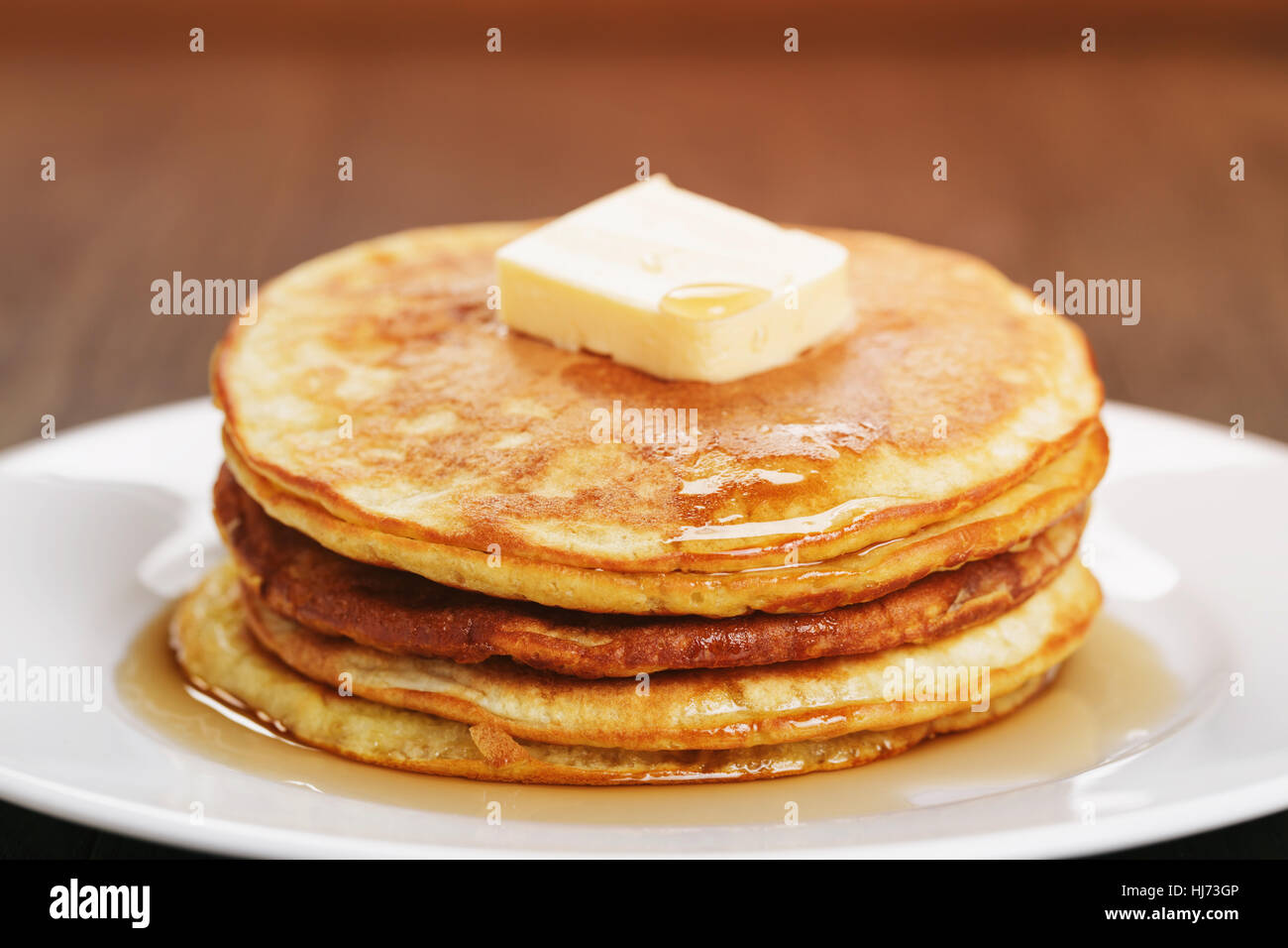 homemade pancakes with butter and maple syrup Stock Photo