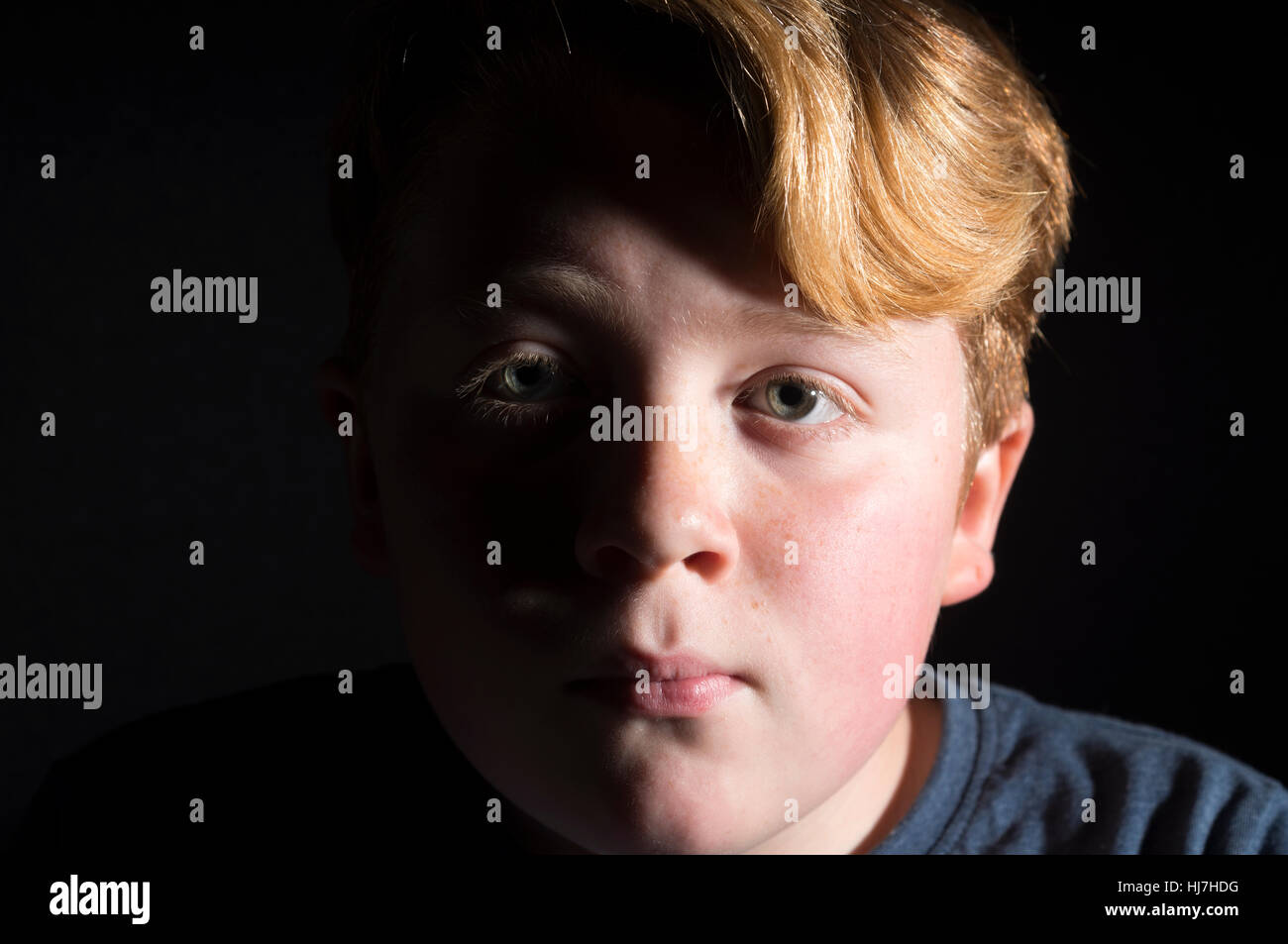 11-year old boy with red hair - Stock Image
