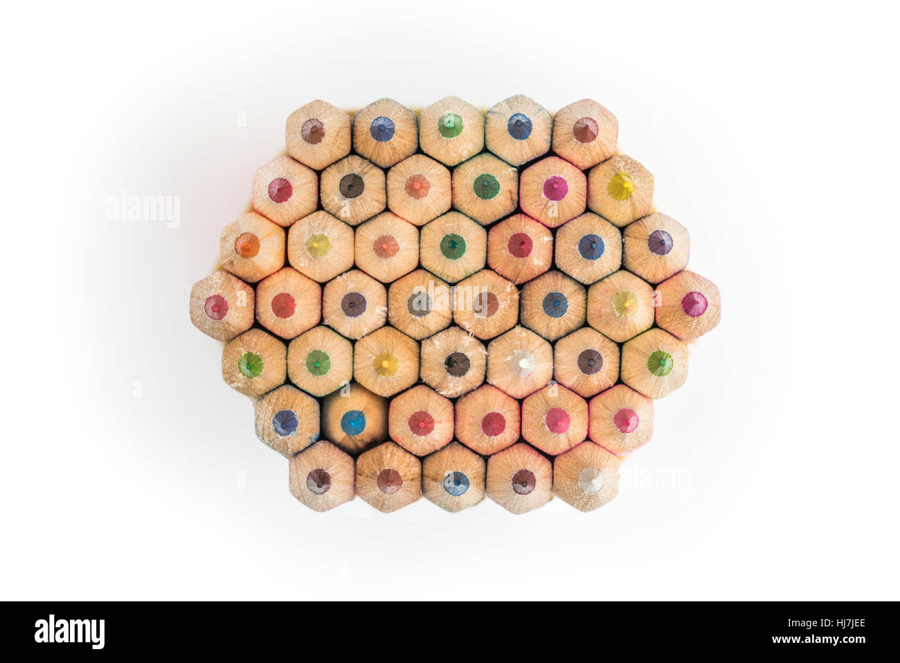 Colouring pencils. Stack of neatly arranged children/s coloured pencils seen from above isolated on white background - Stock Image