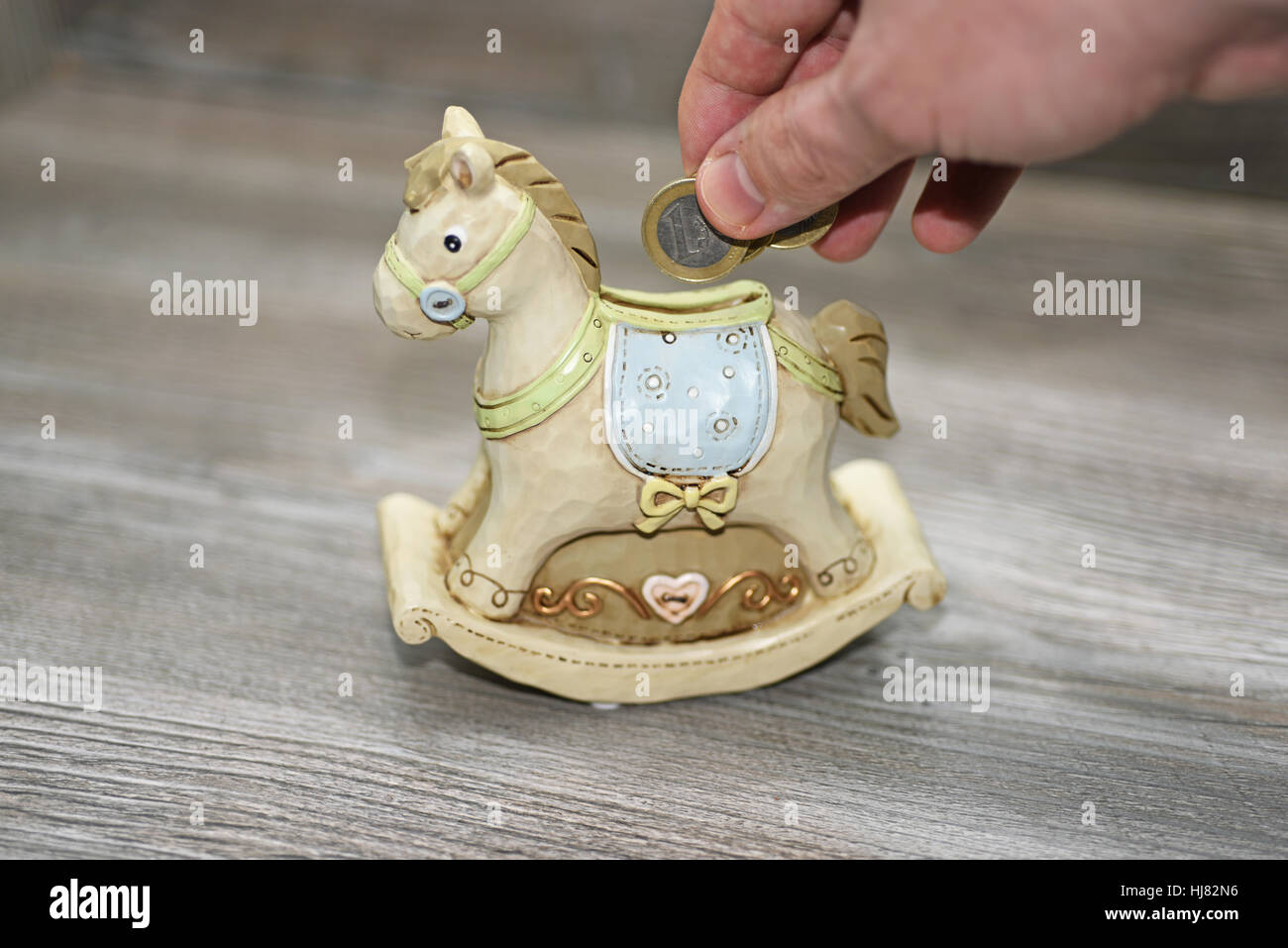 Moneybox in the form of a horse. Stock Photo