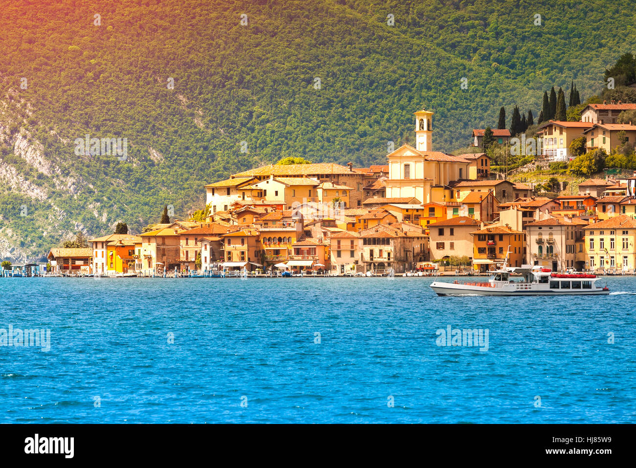View of the city Peschiera Maraglio, a bright sunny day. Region Lombardy, Province Brescia (BS) in Iseo Lake. Italy, Stock Photo