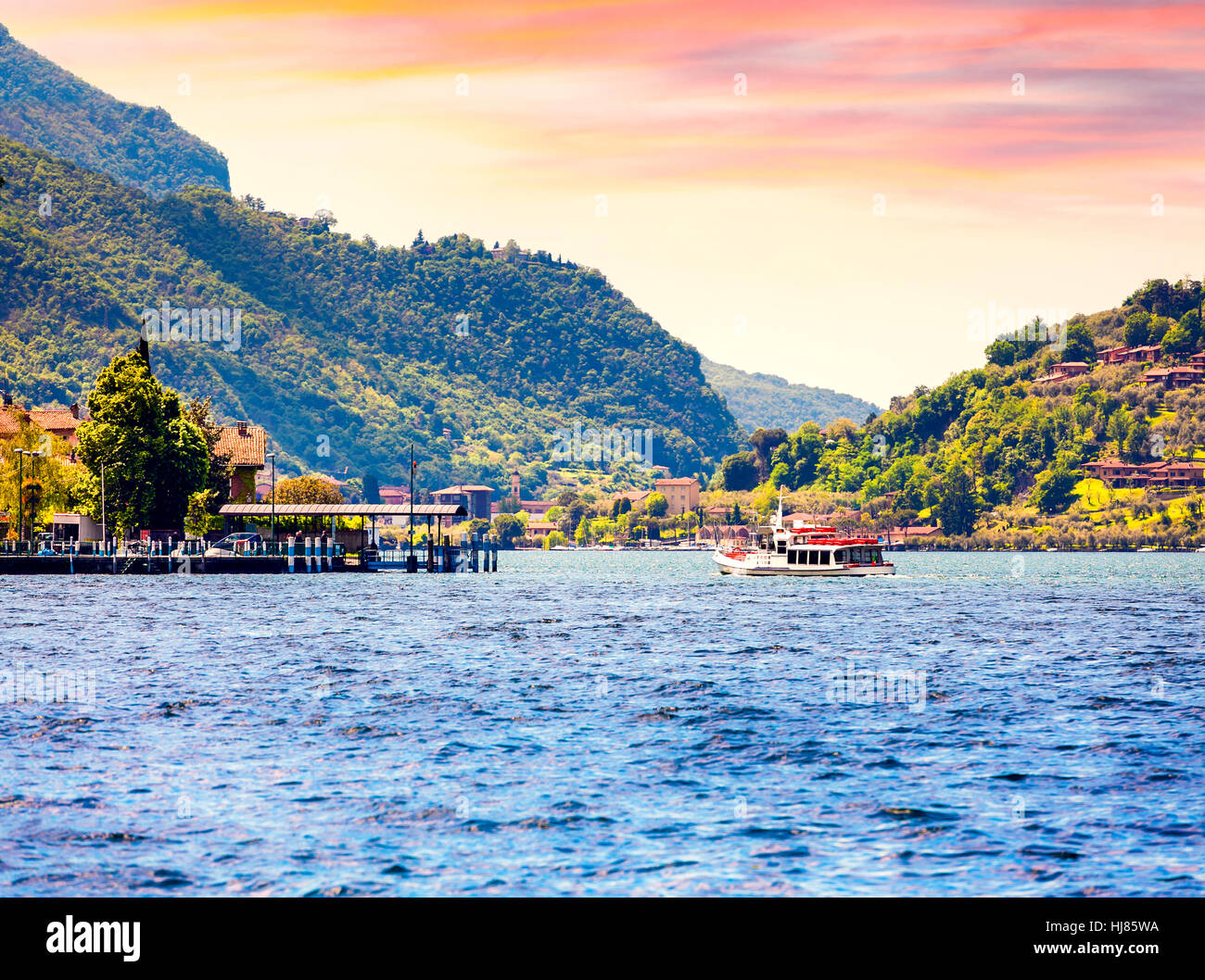 View of the Lake Iseo, colorful summer morning. Region Lombardy, Province Brescia (BS) in Iseo Lake. Italy, Europe. - Stock Image