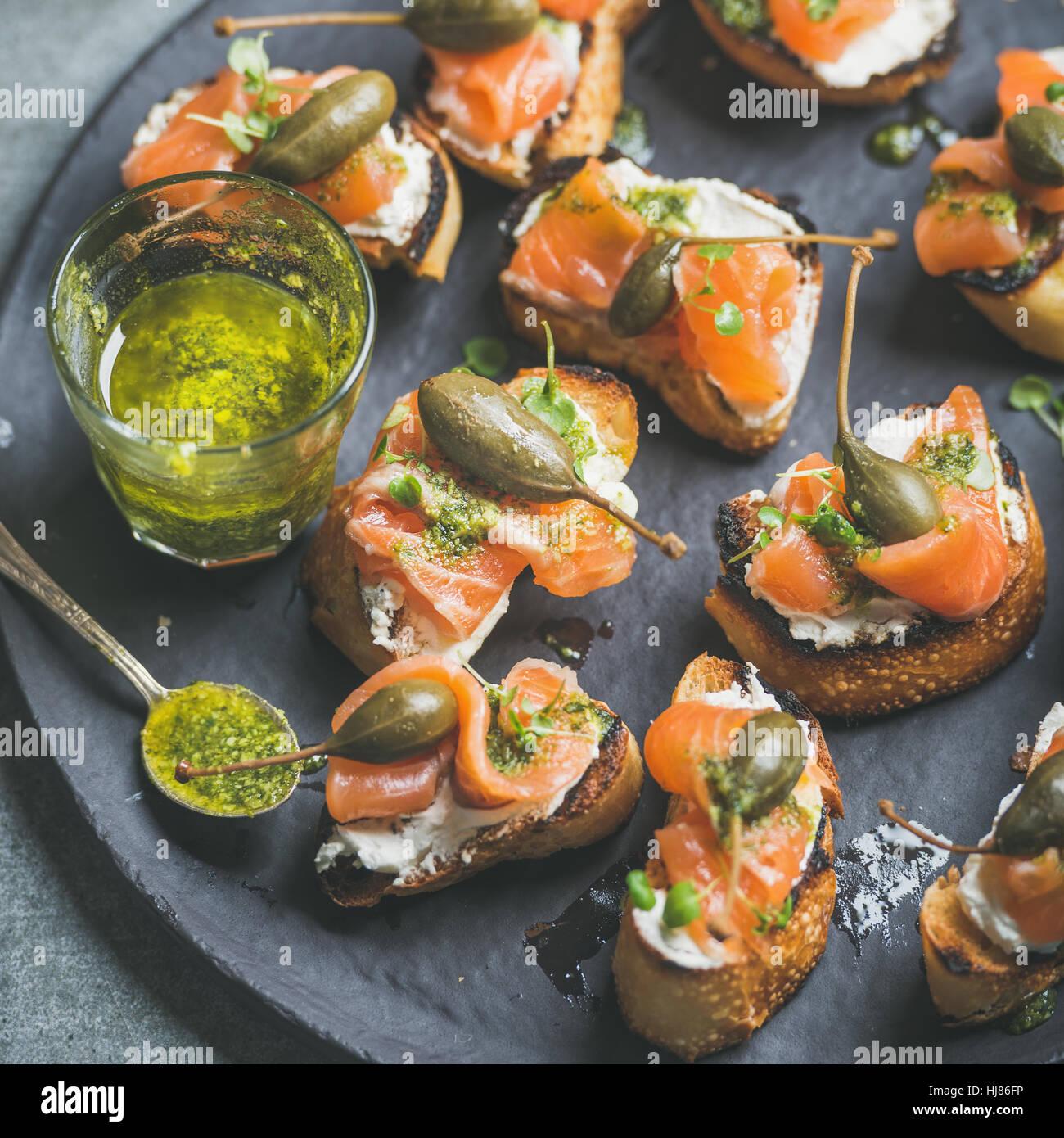 Close-up of salmon crostini with homemade pesto sauce Stock Photo