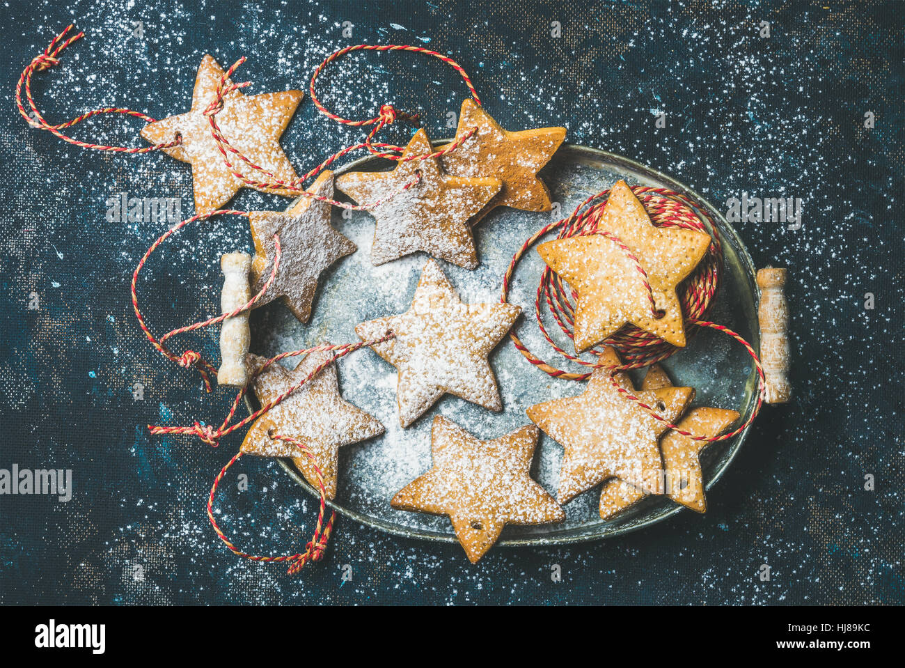Christmas star shaped gingerbread cookies for tree decoration with ropes - Stock Image