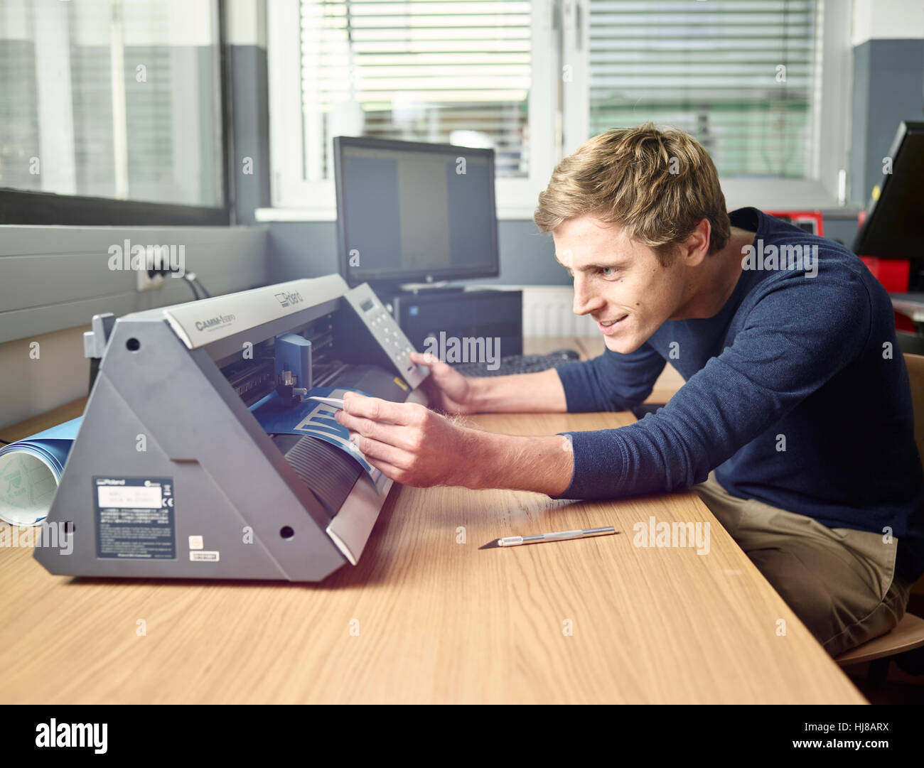 Man with foil cutter, Austria - Stock Image