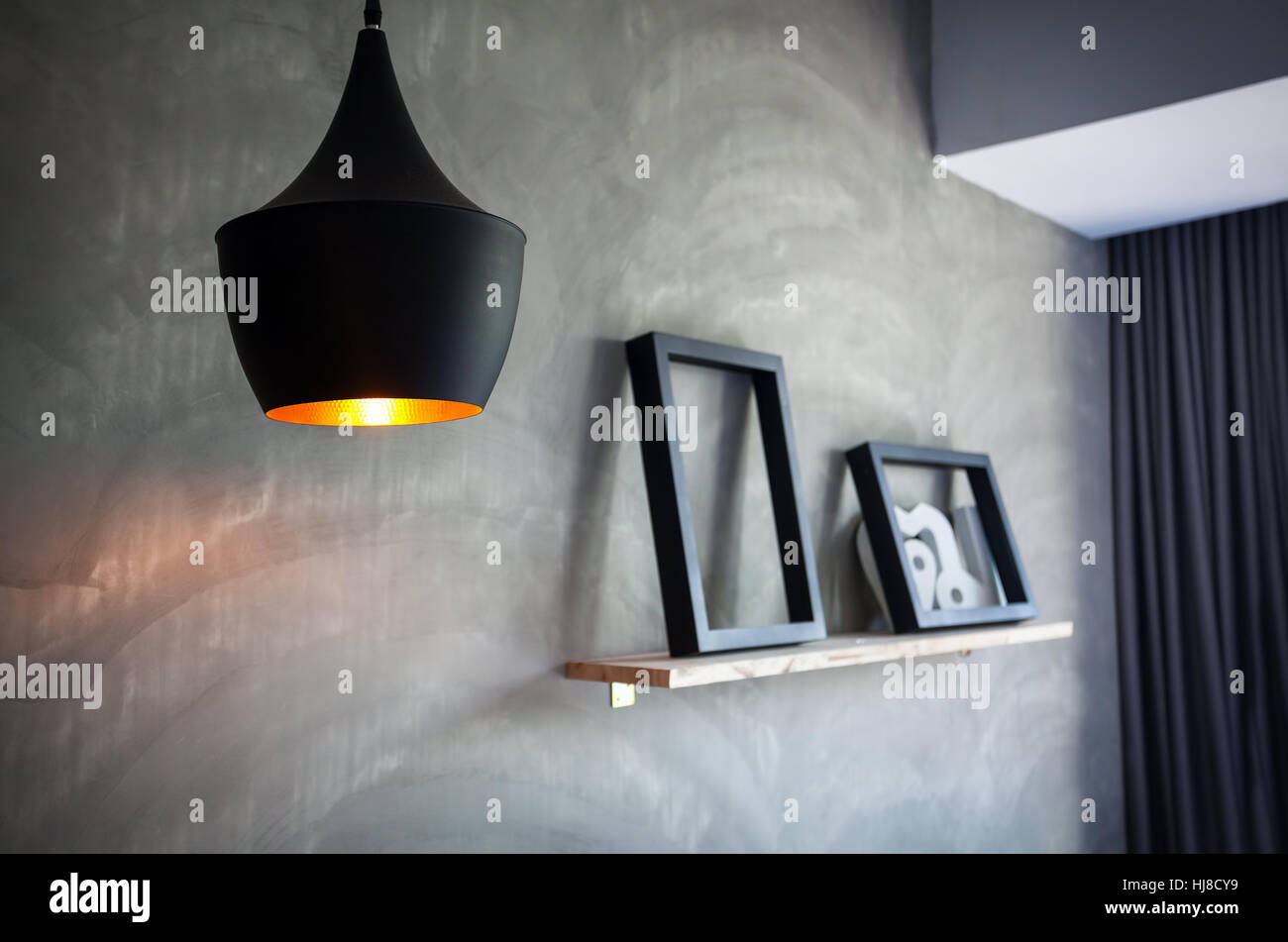 Vintage lantern in the room of loft interior - Stock Image