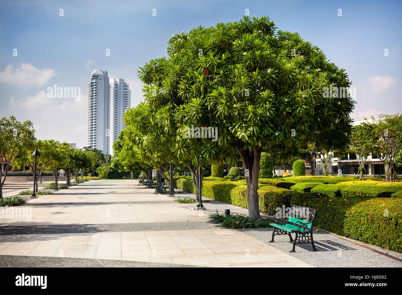 Bench in the park of Rama VII in Bangkok, Thailand - Stock Image