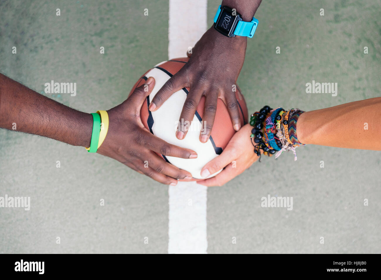Three Multiethnic Friends Stacking Hands. - Stock Image