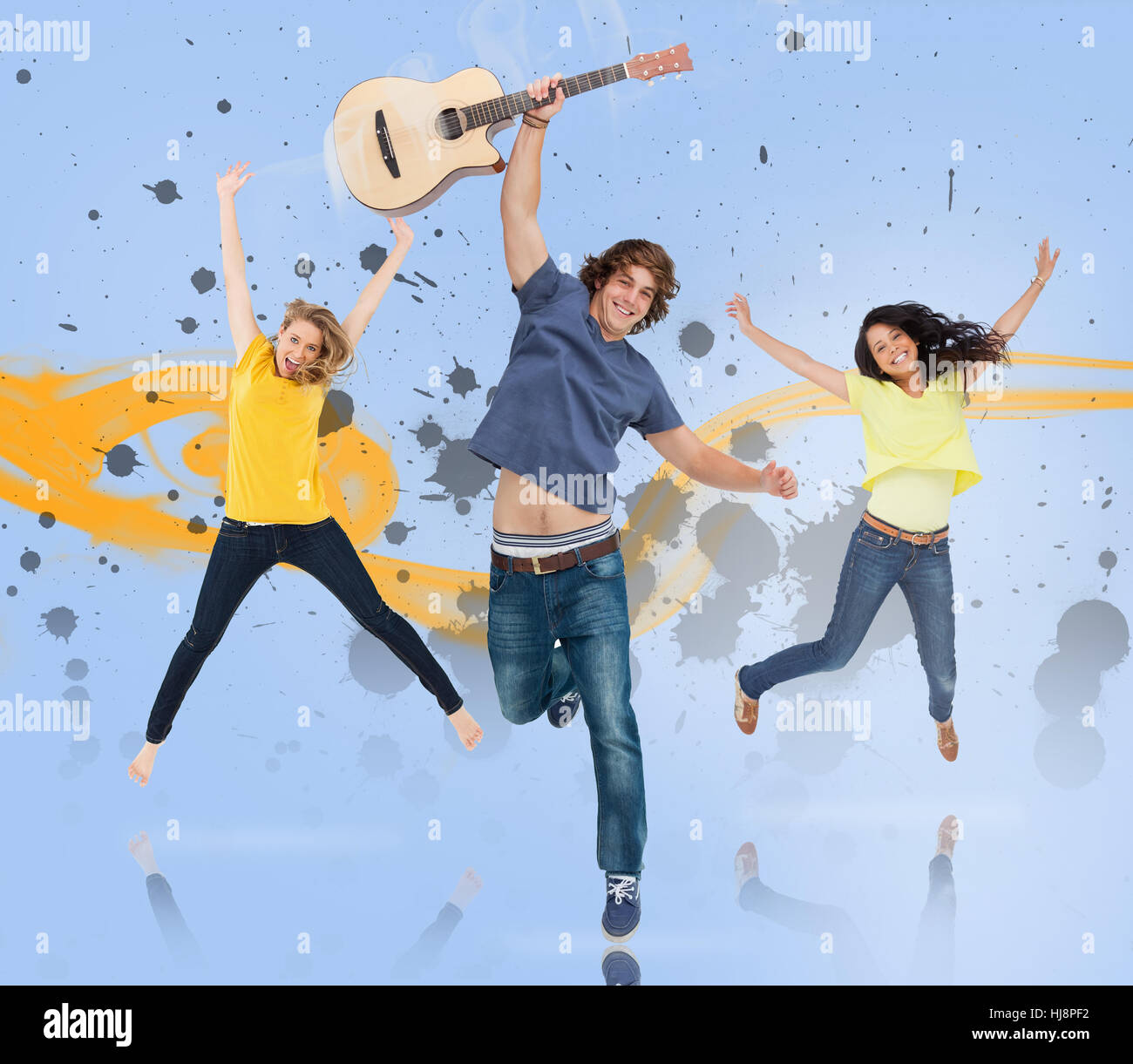 young man with guitar and two girls jumping for joy with yellow