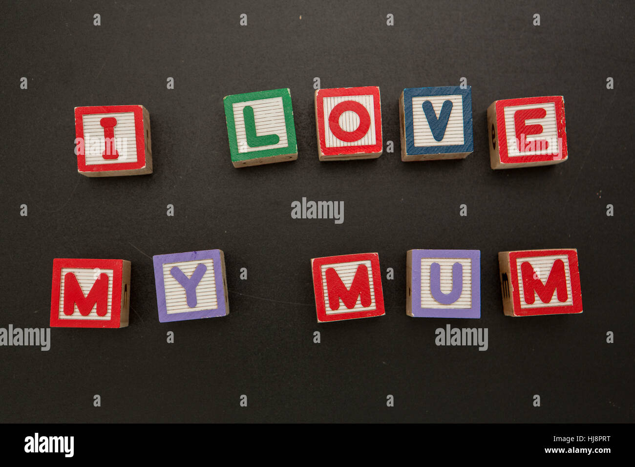 I love my mum message in blocks on chalkboard Stock Photo