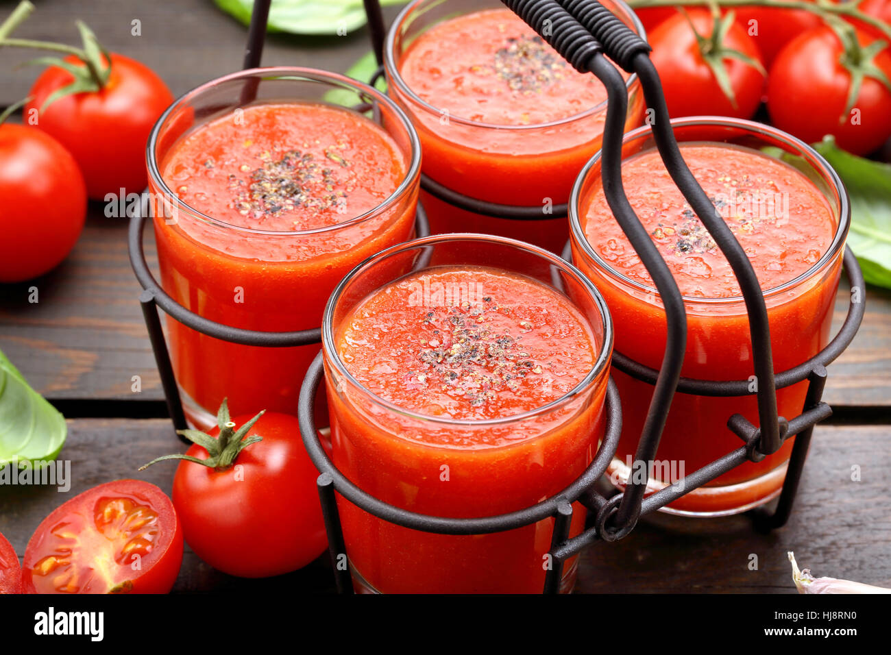 Fresh healthy tomato smoothie juice in metal container on wooden background Stock Photo