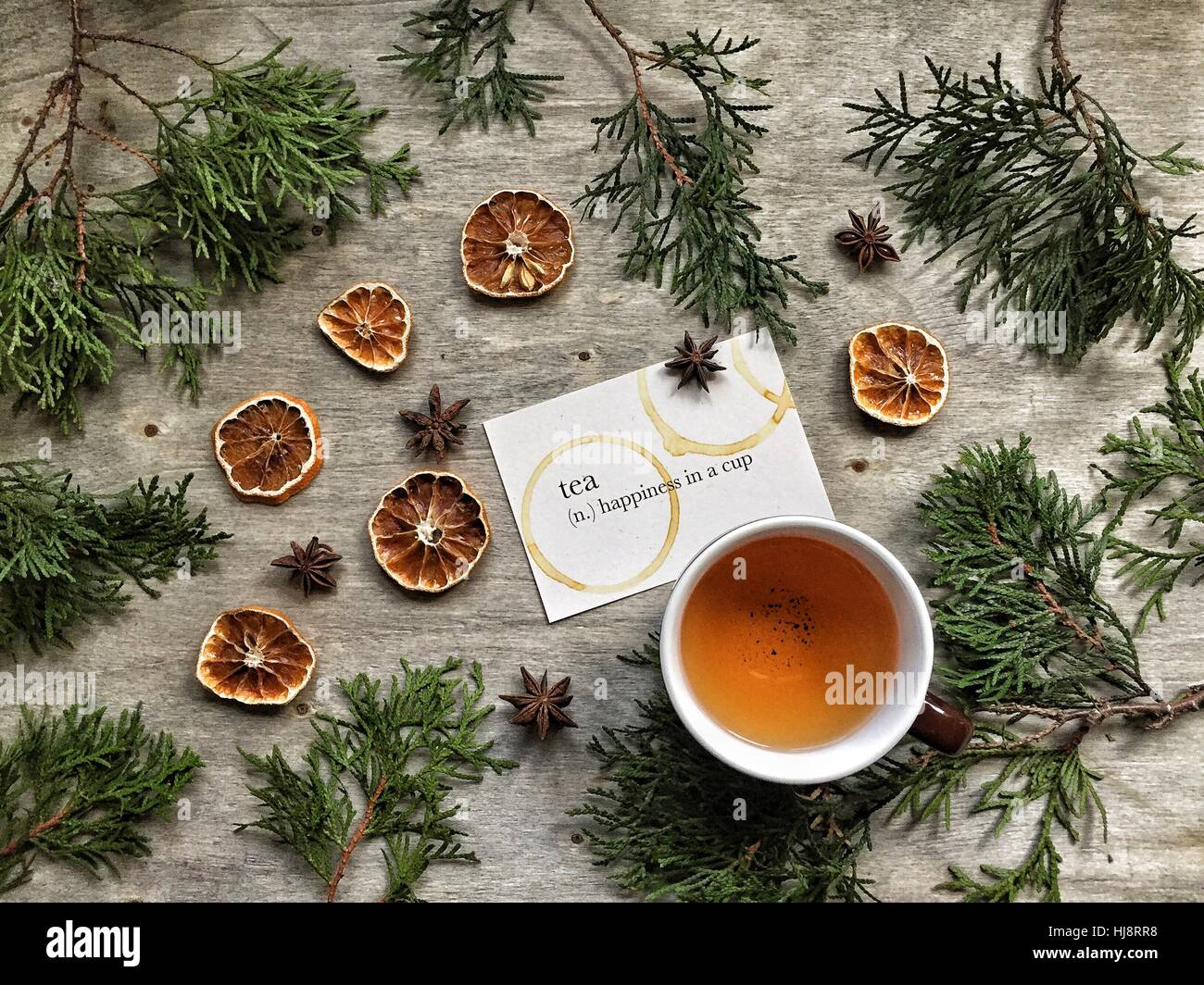 Tea with fir tree branches and dried oranges - Stock Image