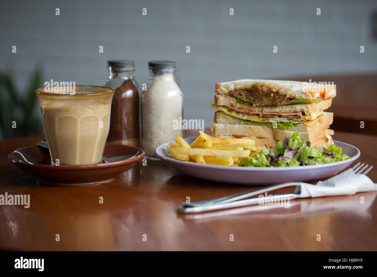 Breakfast club sandwich and coffee - Stock Image