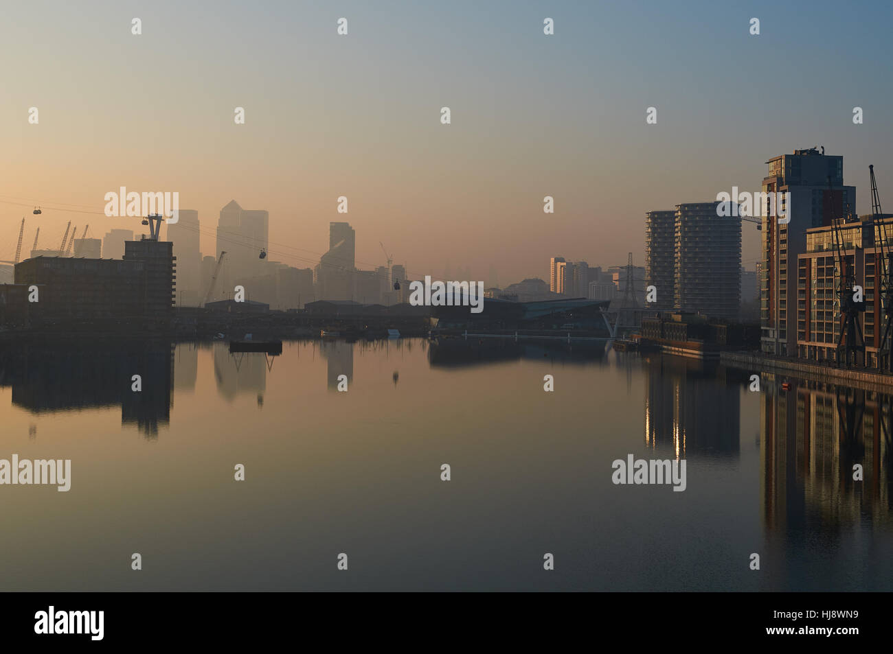 Royal Victoria Dock in January, London UK, looking west towards Canary Wharf - Stock Image