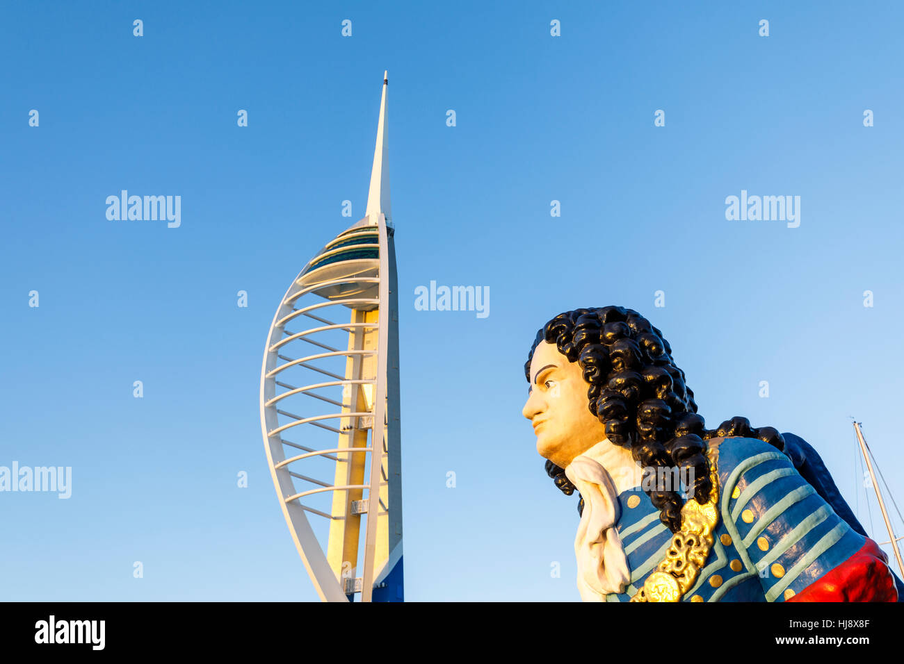 Figurehead of HMS Marlborough and the Emirates Spinnaker Tower at Gunwharf Quays, Portsmouth Harbour, Hampshire, - Stock Image