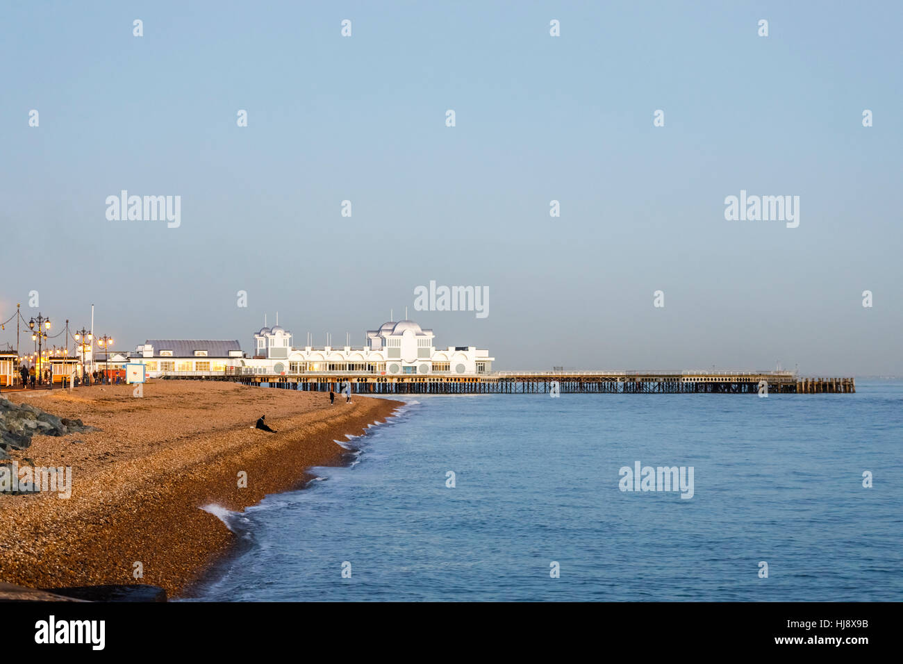 South Parade Pier and the stony beach at Southsea, Portsmouth, Hampshire, southern England in late afternoon/early evening light Stock Photo