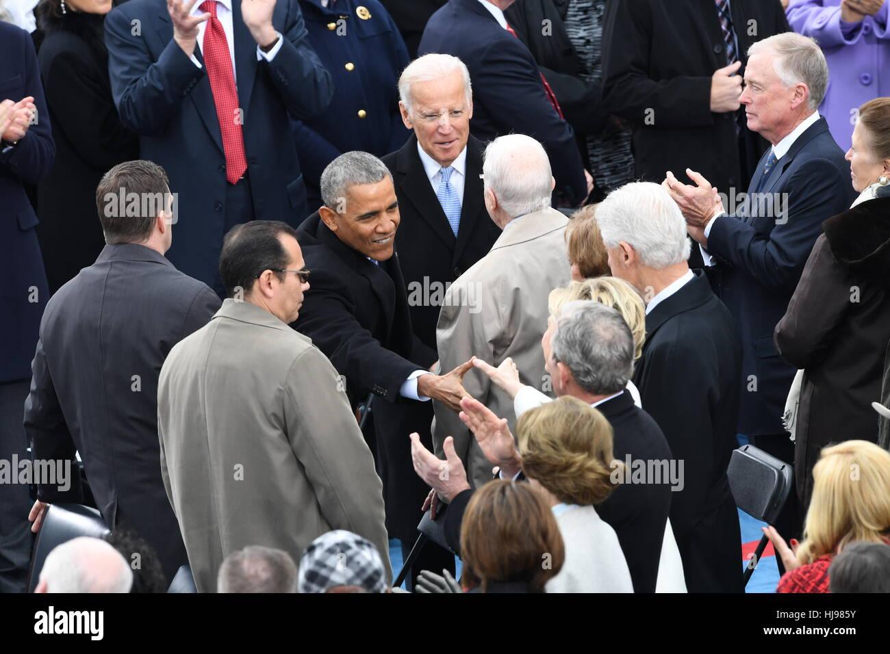 President Barack Obama Greets Former Secretary Of State Hillary