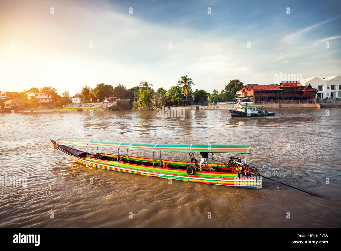 Longtail boat cruise by Chao Phraya river in Ancient city Ayutthaya, Thailand - Stock Image