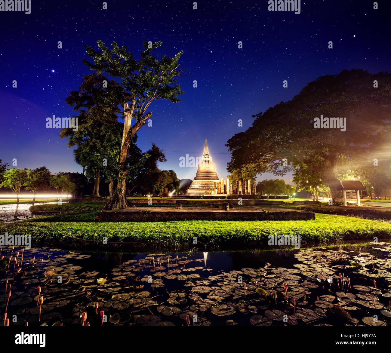 Light show in Golden Stupa Buddhist Temple in Sukhothai Historical Park, Thailand Stock Photo