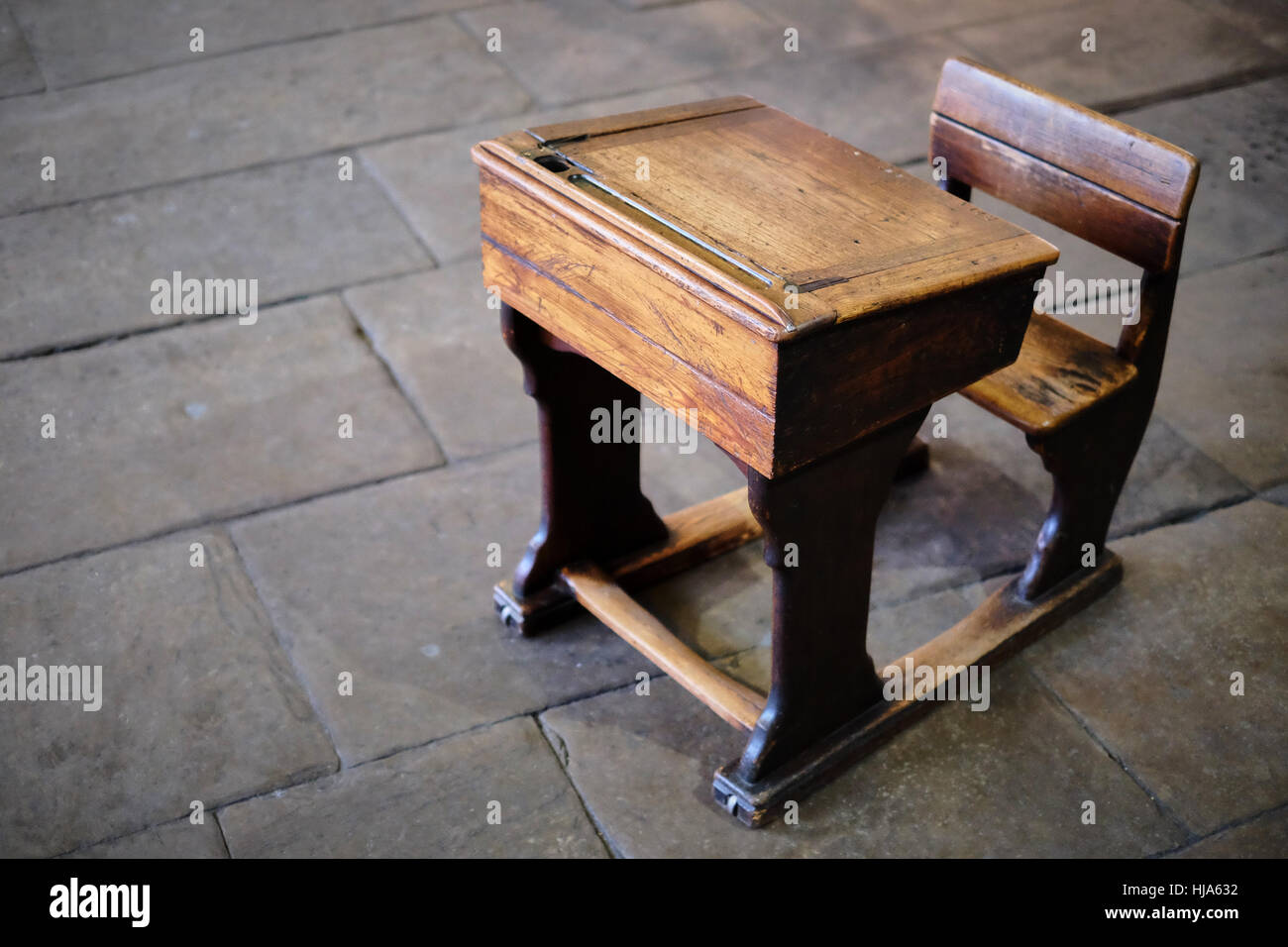 Antique, vintage, wooden school desk and chair on a Yorkshire stone flagged  floor - Antique, Vintage, Wooden School Desk And Chair On A Yorkshire Stone