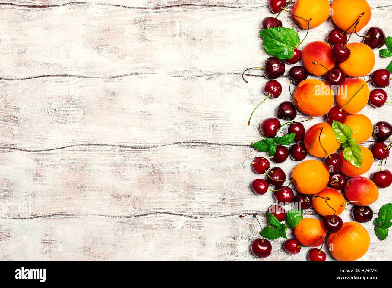 Summer Fruits On White Wooden Table Apricots And Cherries Rustic Background Top View Copy Space