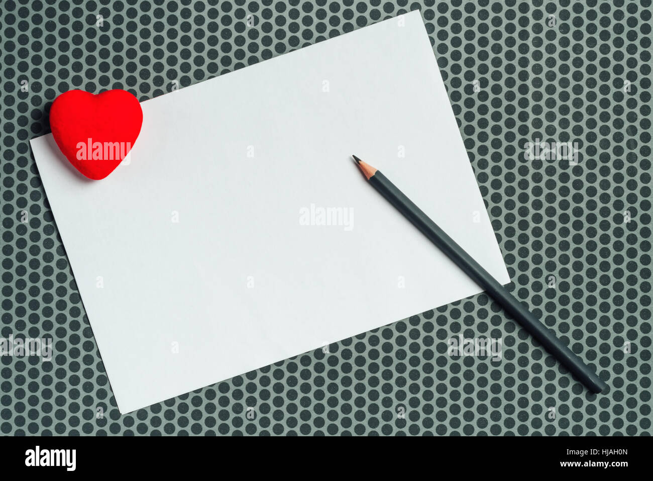 Love letter mock up, blank valentine's day card with red heart and pencil, copy space - Stock Image