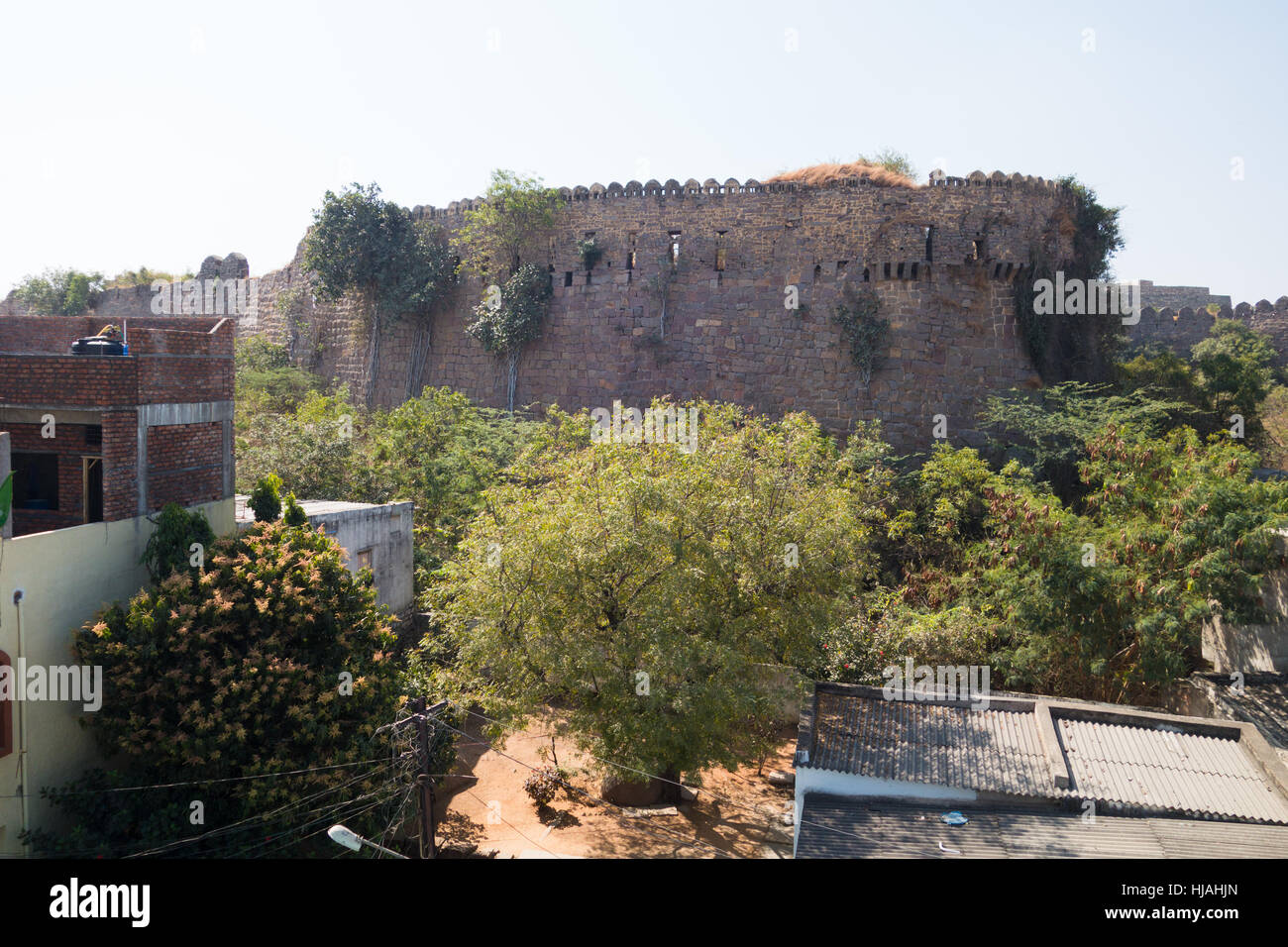 HYDERABAD,INDIA - JAN.21,2017 Residential houses outside the wall of 400 year old Golconda Fort in Hyderabad,India - Stock Image