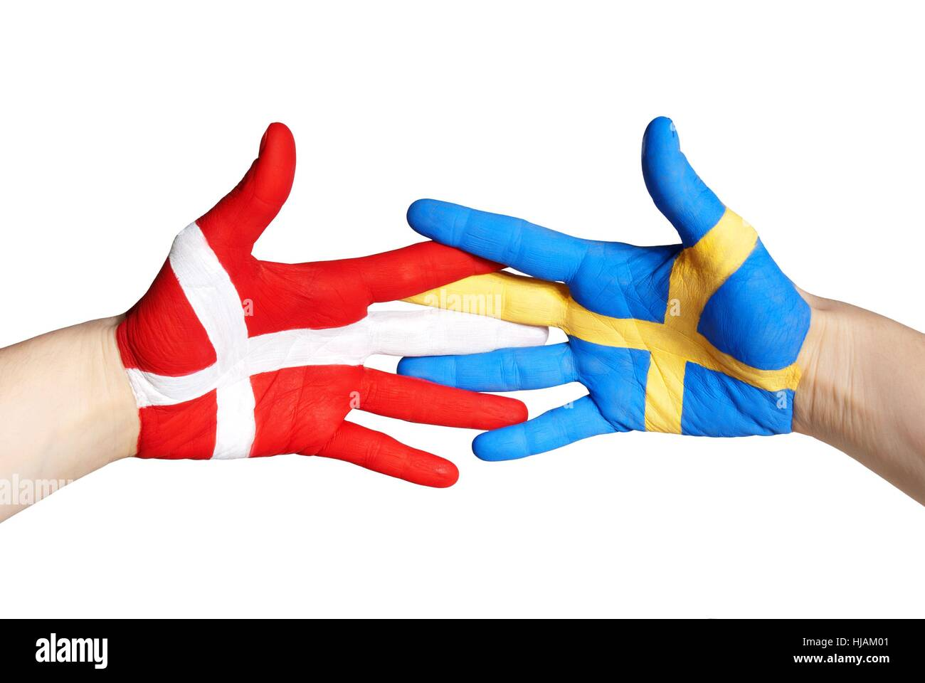 two hands painted in the colors of denmark and sweden shaking - Stock Image