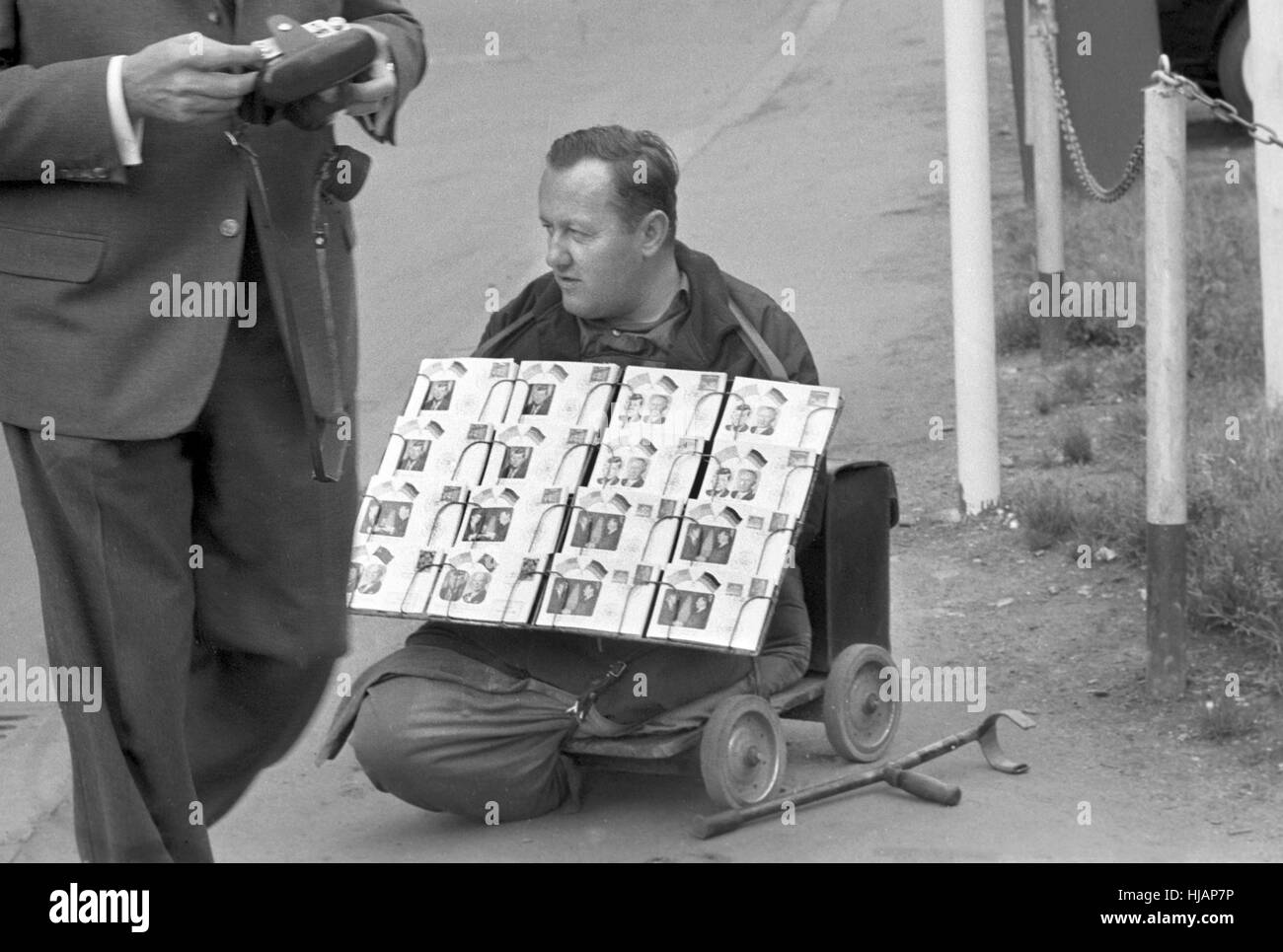 People can buy special postcards with the picture of the american president John F. Kennedy in honour of his visit - Stock Image
