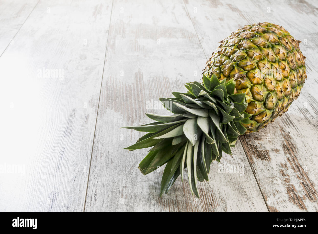 pineapple lying on the right - Stock Image