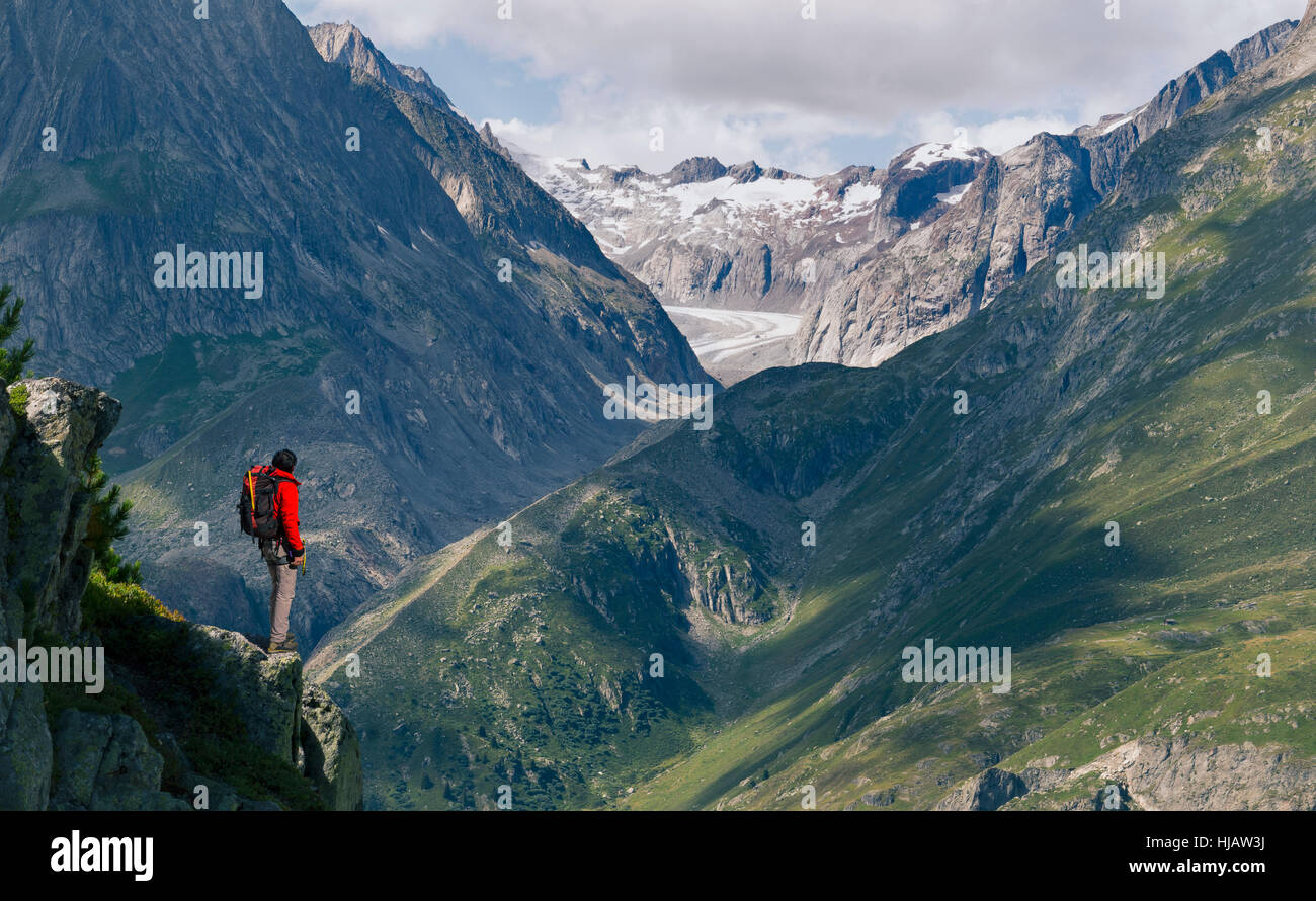 Lone male climber looking out from ridge,  Aletsch Glacier, Canton Wallis, Switzerland Stock Photo