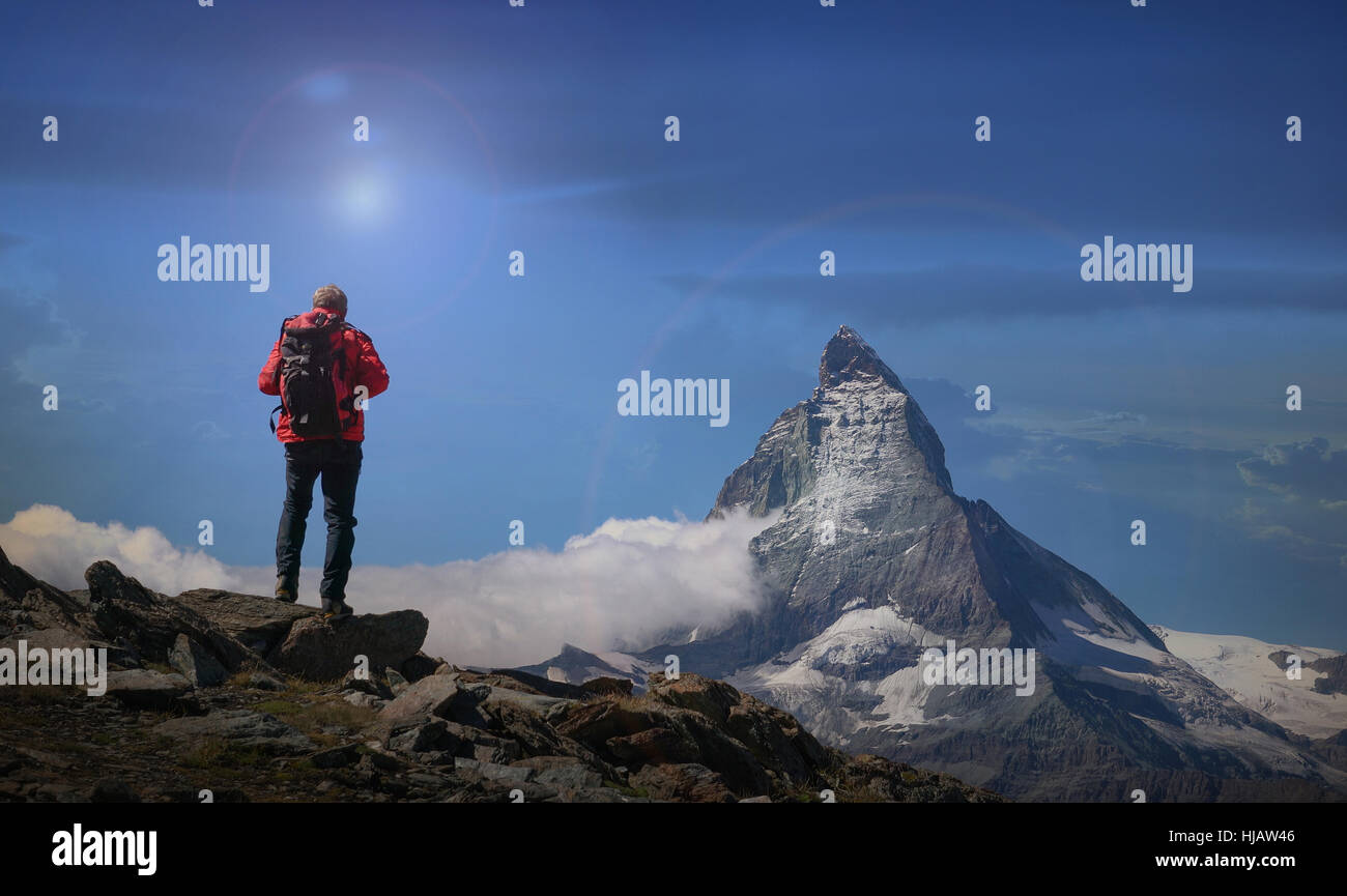 Rear view of senior male climber looking out at Matterhorn, Canton Wallis, Switzerland - Stock Image